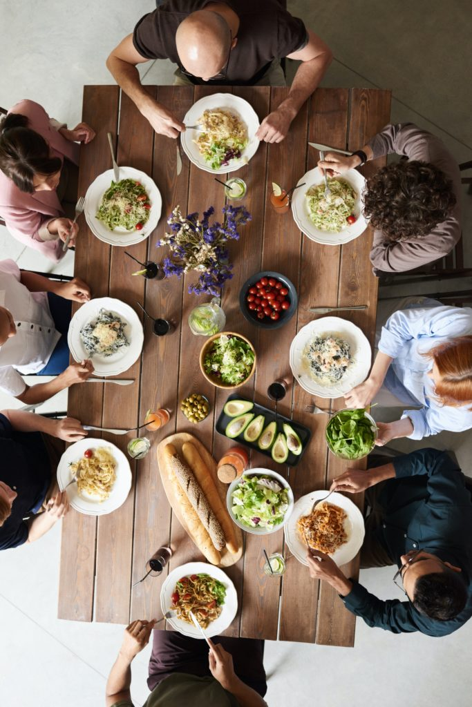 group-of-people-eating-together-3184195